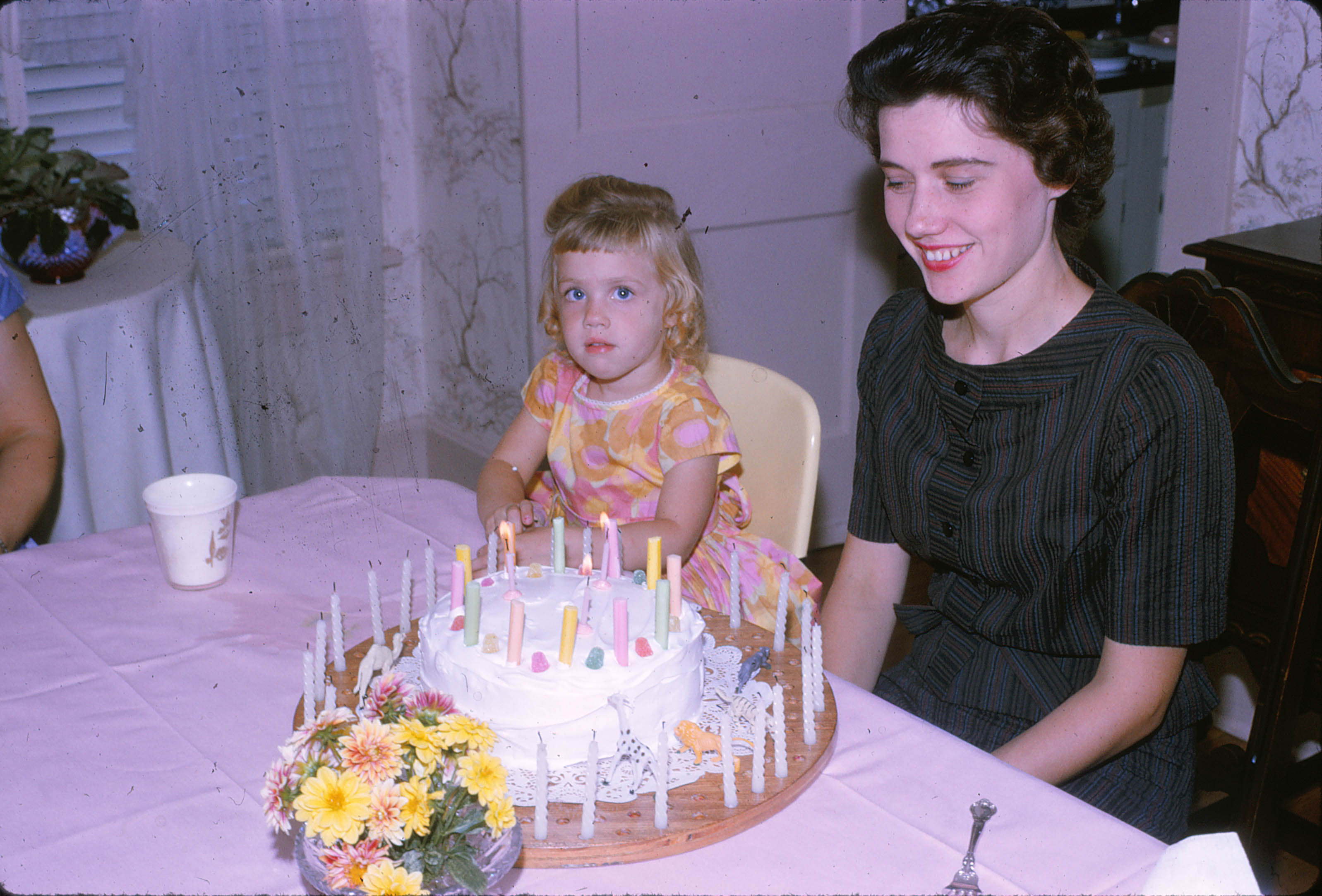 Mom and I share the same birthday. Here I'm 3, she's 26.