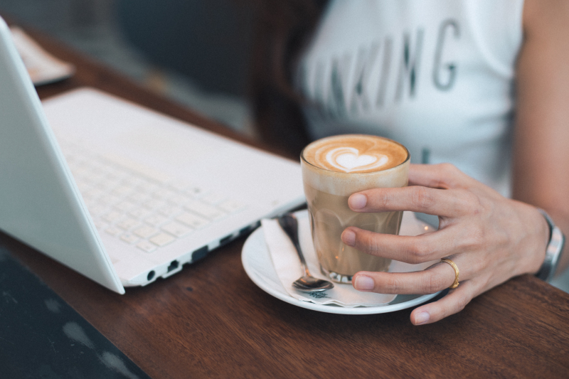 Womans hand holding coffee